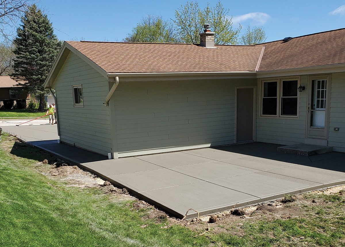 complete concrete construction ccc patio and driveway wrap around house