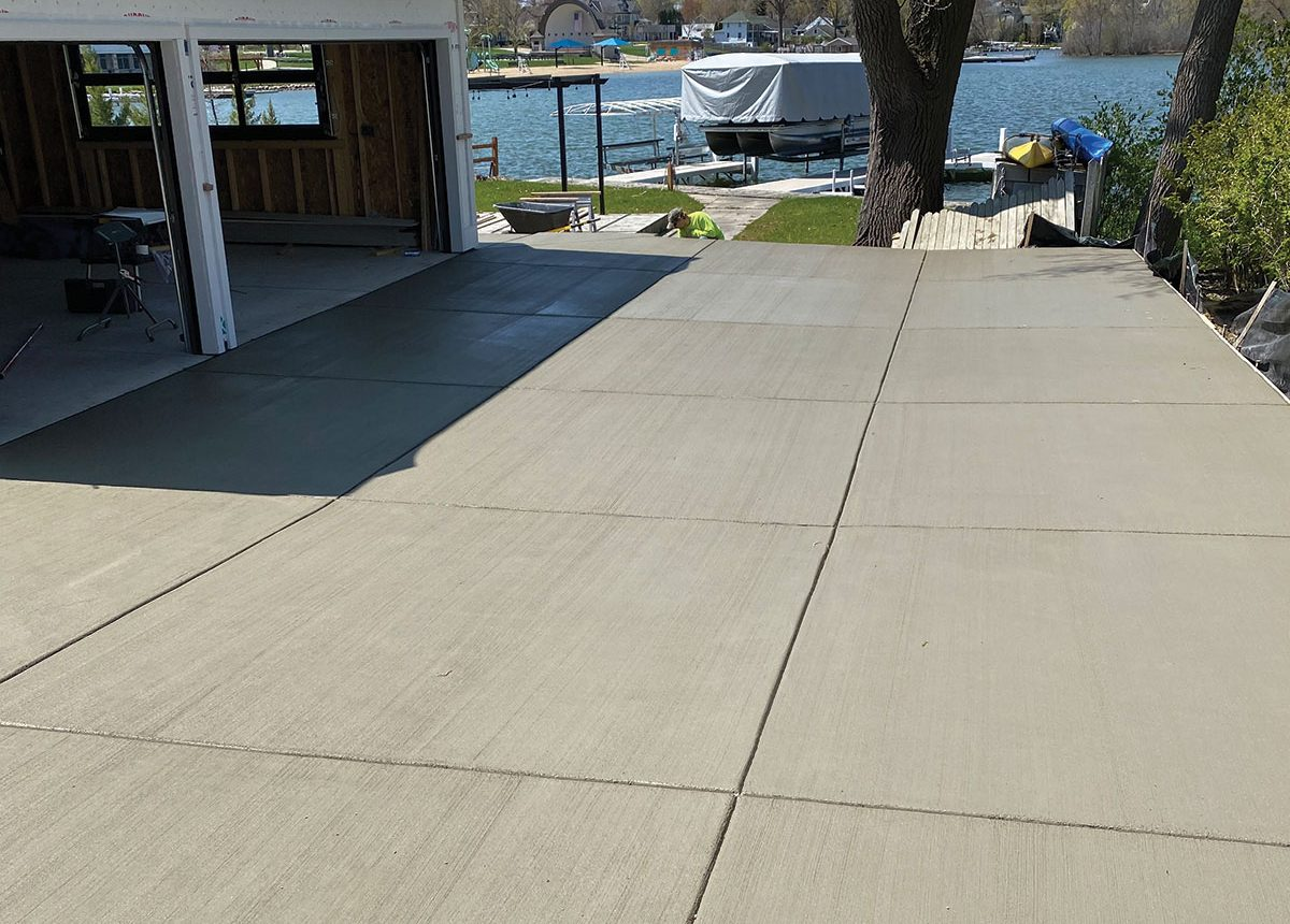 complete concrete construction ccc residential driveway for house on lake