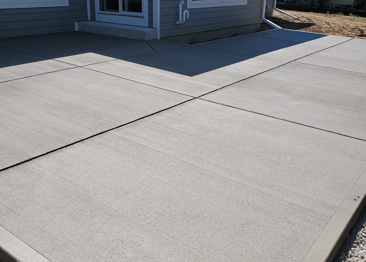 complete concrete construction finishes new patio for a home residential build