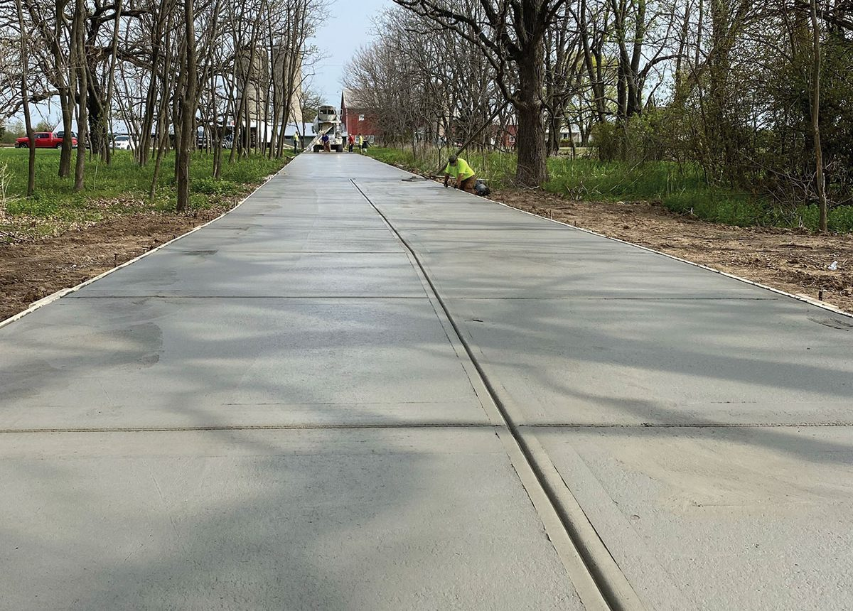 long rural residential home driveway by complete concrete construction