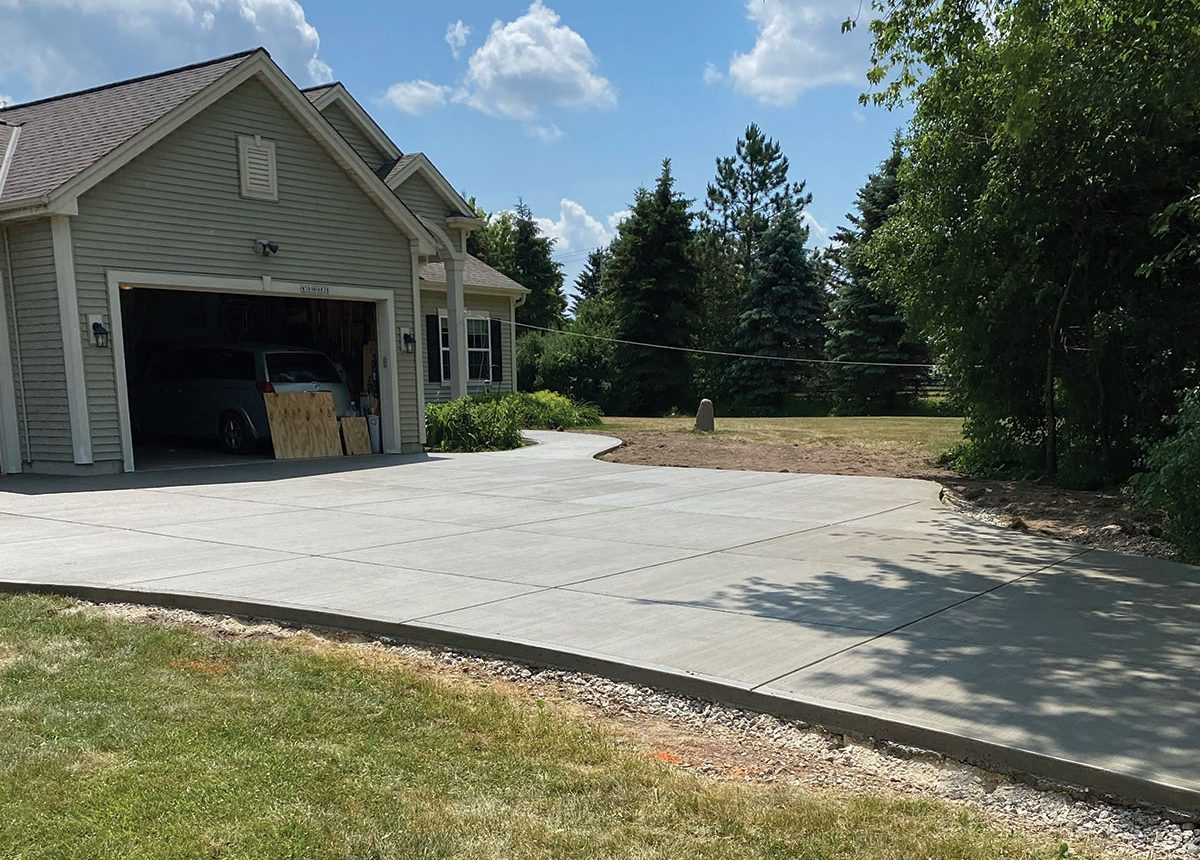 new concrete paved driveway for residential home by complete concrete construction