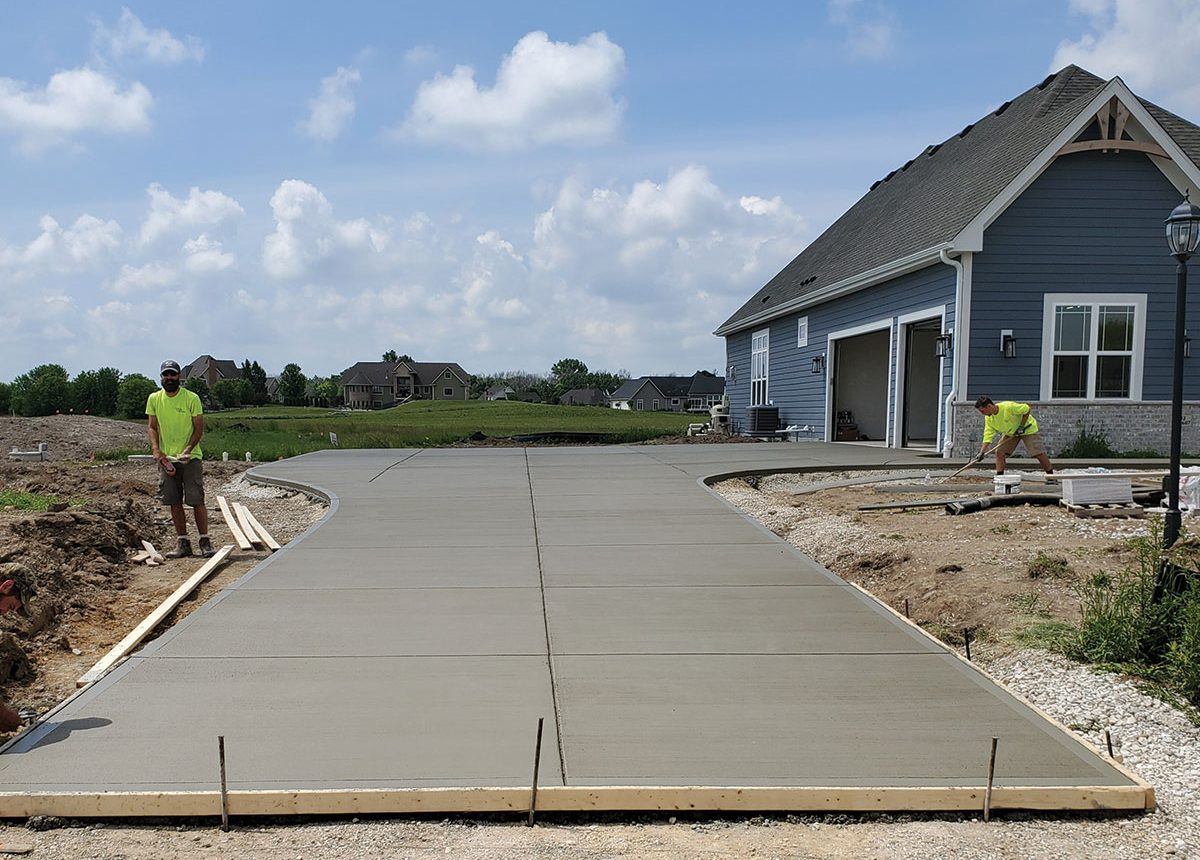new construction residential home driveway concrete paved design