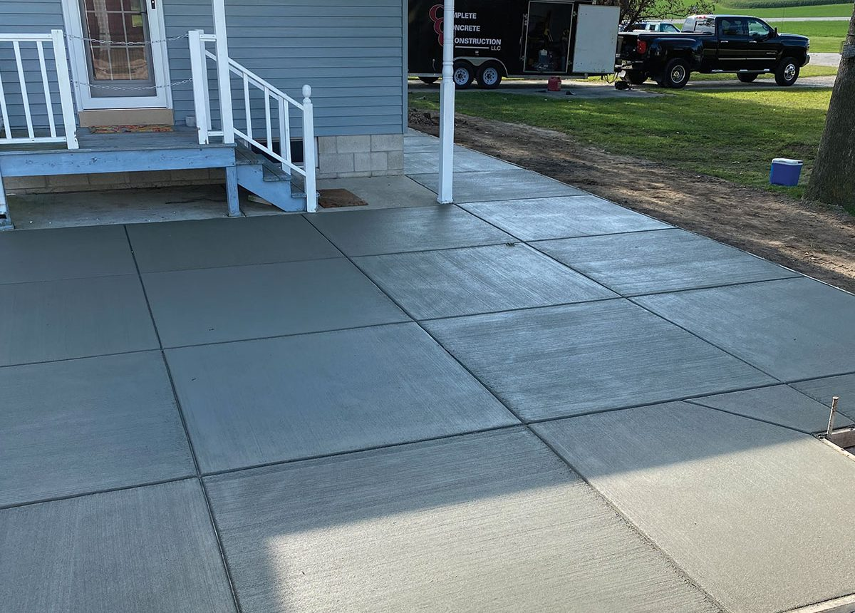new residential home concrete paved patio backyard by ccc